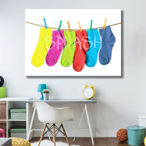 Picture Coloured socks hung with tweezers