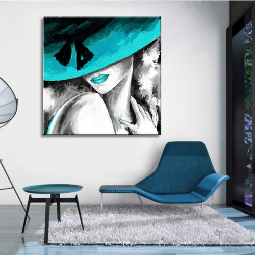 Woman painting with turquoise hat