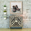 Impressionist painting with boots and frame