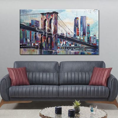 New York painting with skyline and Brooklyn bridge and colorful buildings on top of the original large format sofa