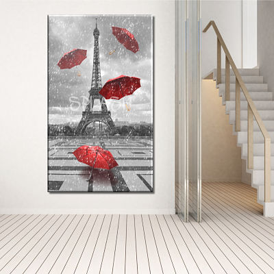 Picture of Paris Eiffel Tower with red hats in the rain black and white printed on canvas
