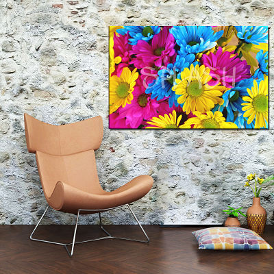 Picture of flowers printed on canvas with brightly colored daisies